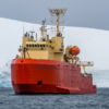 The R/V Laurence M. Gould in front of an Antarctic glacier.