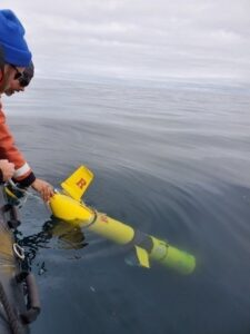 Scientists deploy a Slocum Glider off the coast of Antarctica.
