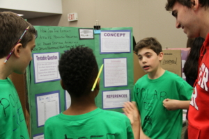 Students presenting a poster at a Polar Science Research Symposium